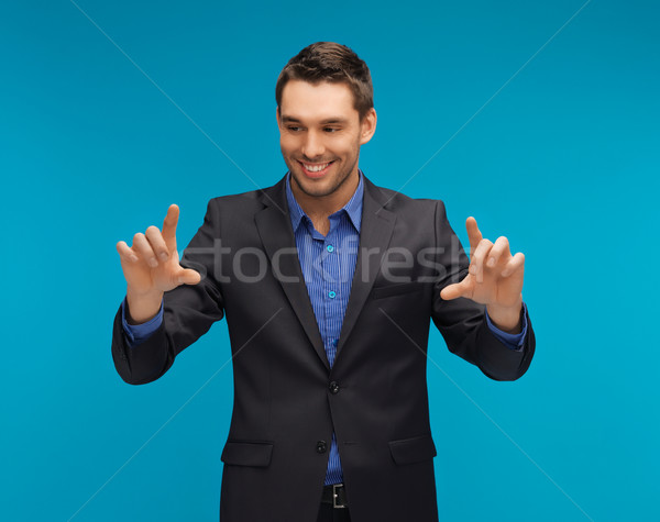 man in suit working with something imaginary Stock photo © dolgachov