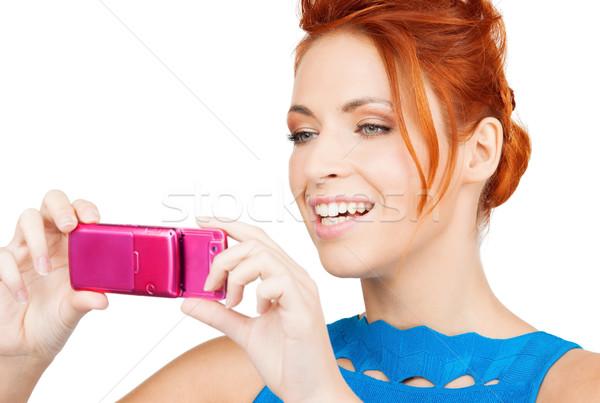 Vrouw mobiele telefoon foto glimlachende vrouw foto Stockfoto © dolgachov