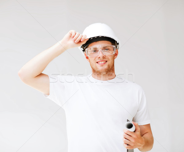 male architect in helmet with blueprint Stock photo © dolgachov