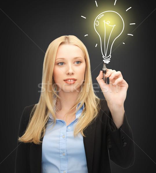 Donna disegno business energia ambiente Foto d'archivio © dolgachov