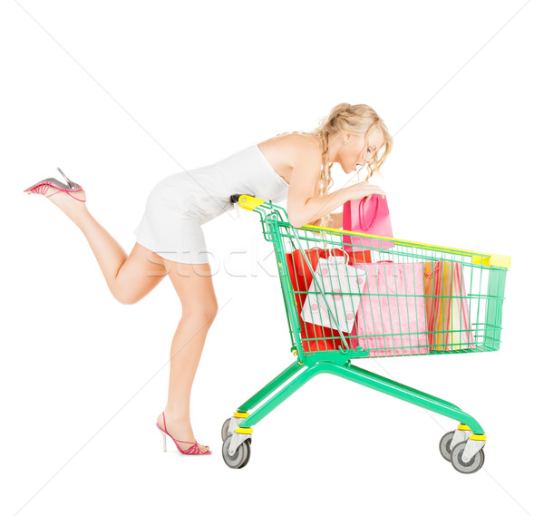 happy woman with shopping cart and bags Stock photo © dolgachov