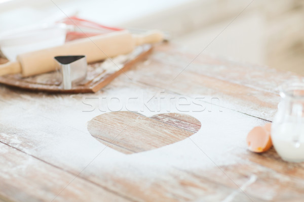 close up of heart of flour on wooden table at home Stock photo © dolgachov