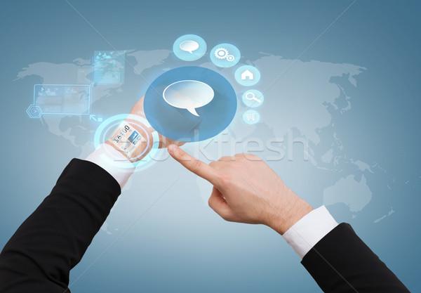 businessman pointing to virtual watch at his hand Stock photo © dolgachov
