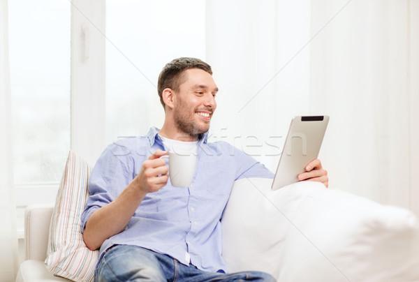 Glimlachend man werken home lifestyle Stockfoto © dolgachov