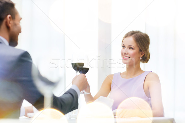 young woman looking at boyfriend or husband Stock photo © dolgachov