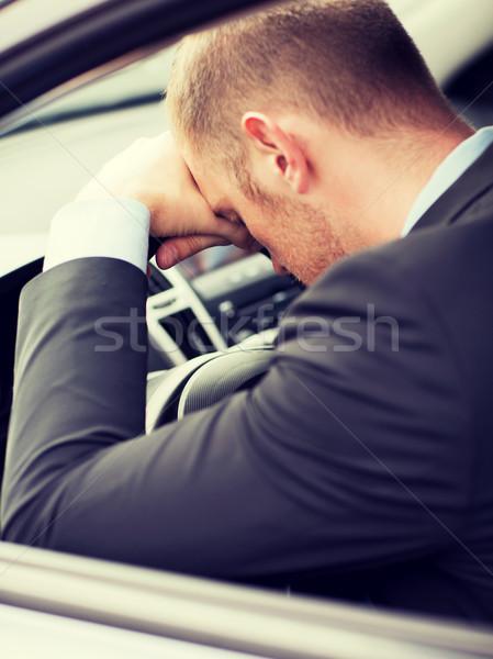 tired businessman or taxi car driver Stock photo © dolgachov