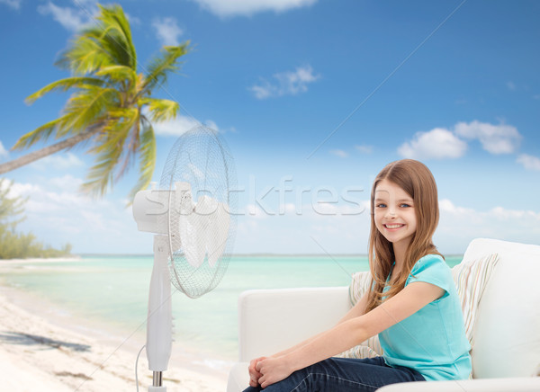 smiling little girl with big fan at home Stock photo © dolgachov