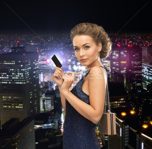 woman in evening dress with vip card Stock photo © dolgachov