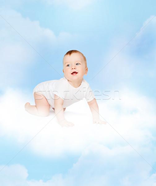 Kúszás mosolyog baba felfelé néz gyermek kisgyerek Stock fotó © dolgachov