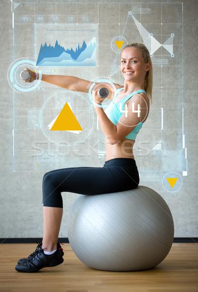 Sorrindo halteres exercer bola fitness esportes Foto stock © dolgachov
