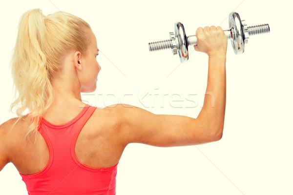 Kobieta ciężki stali powrót Zdjęcia stock © dolgachov