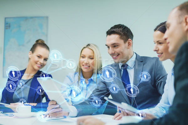 business team with tablet pc having discussion Stock photo © dolgachov