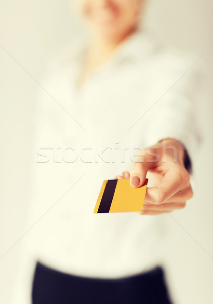 woman showing gold credit card Stock photo © dolgachov