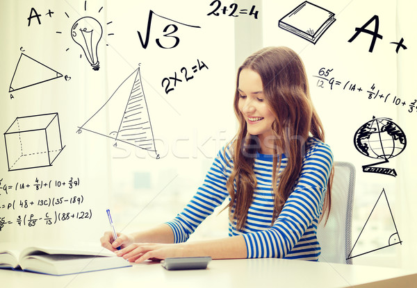 Stock photo: student girl with book, notebook and calculator
