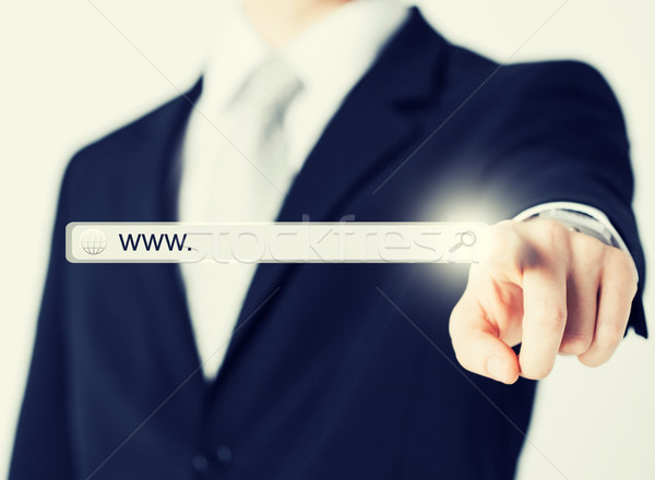 businessman pressing Search button Stock photo © dolgachov