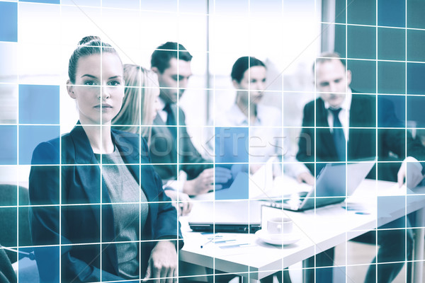 businesswoman and business team at office the back Stock photo © dolgachov