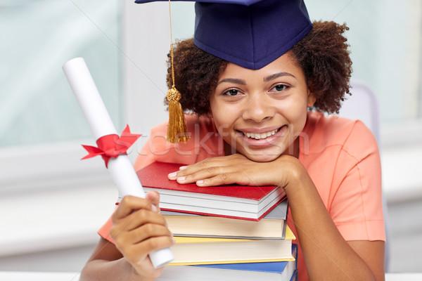 Glücklich african Bachelor Mädchen Pfund Diplom Stock foto © dolgachov
