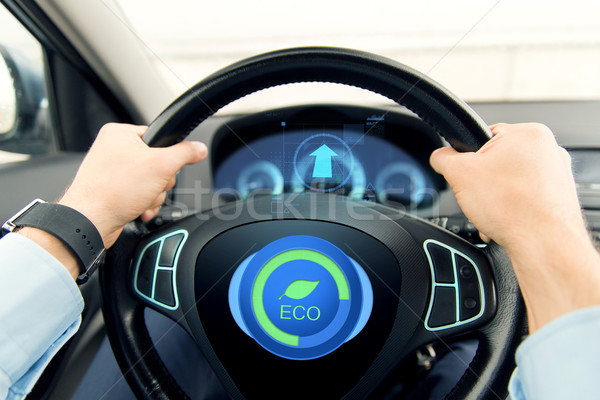 close up of young man driving car in eco mode Stock photo © dolgachov