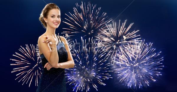 beautiful woman in evening dress over firework Stock photo © dolgachov