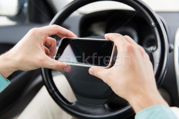 男 手 スマートフォン 運転 車 ストックフォト © dolgachov