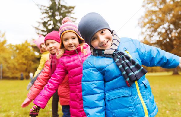 Grupo feliz ninos otono parque Foto stock © dolgachov