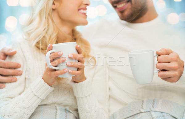Közelkép boldog pár teáscsészék otthon tél Stock fotó © dolgachov