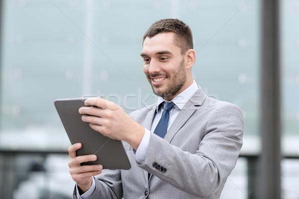 Сток-фото: улыбаясь · бизнесмен · улице · бизнеса · образование