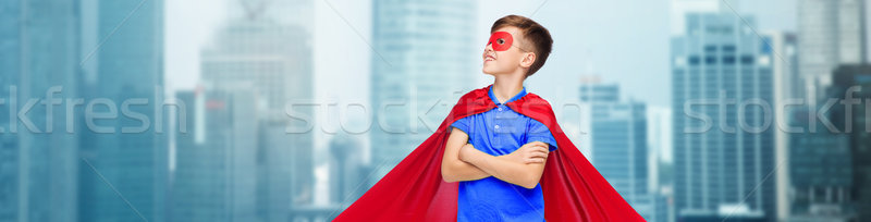boy in red super hero cape and mask Stock photo © dolgachov