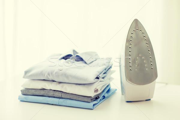 Közelkép vasaló ruházat asztal otthon vasalás Stock fotó © dolgachov