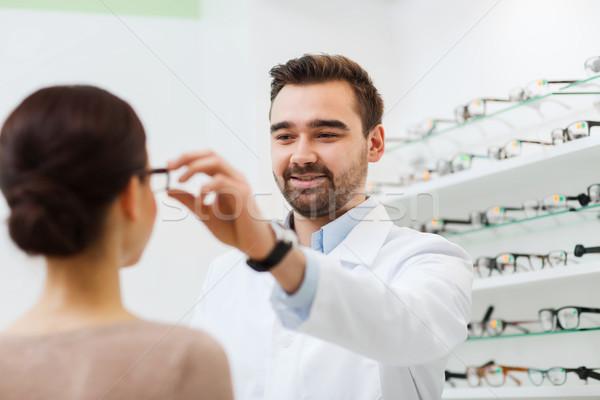 оптик очки женщину оптика магазине Сток-фото © dolgachov