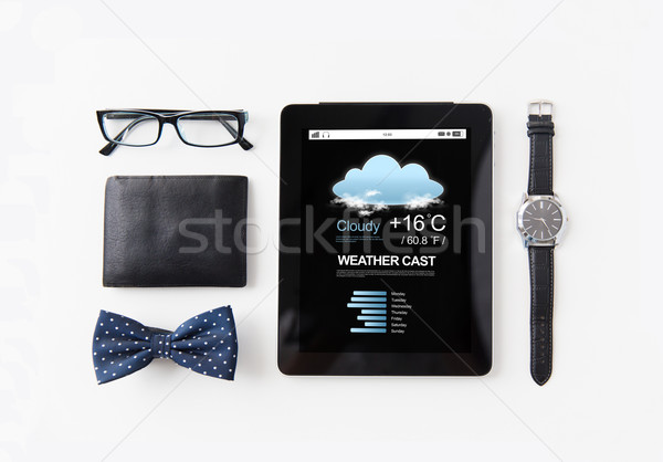 tablet pc with weather cast and personal stuff Stock photo © dolgachov