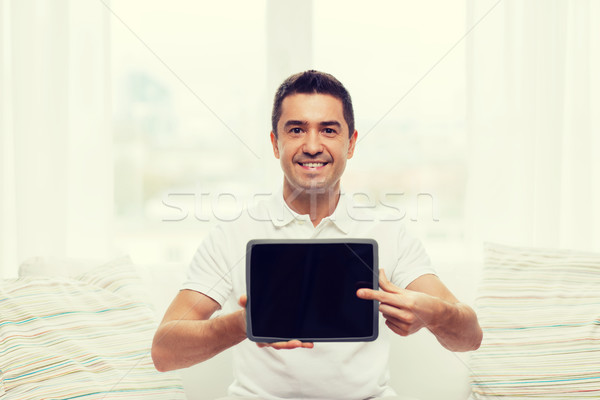 Stock photo: smiling man showing tablet pc blank screen at home