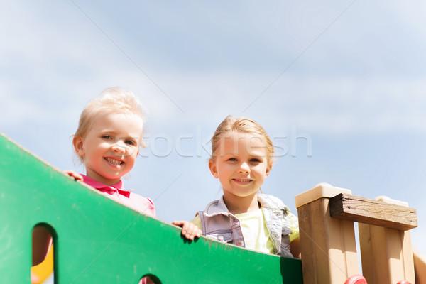happy little girls on children playground Stock photo © dolgachov
