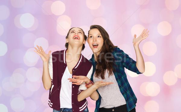 happy smiling pretty teenage girls having fun Stock photo © dolgachov