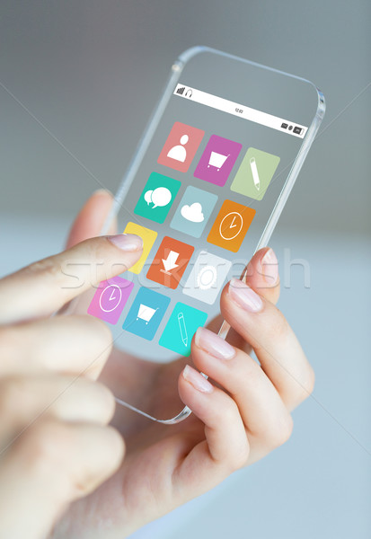 close up of woman with app icons on smartphone Stock photo © dolgachov