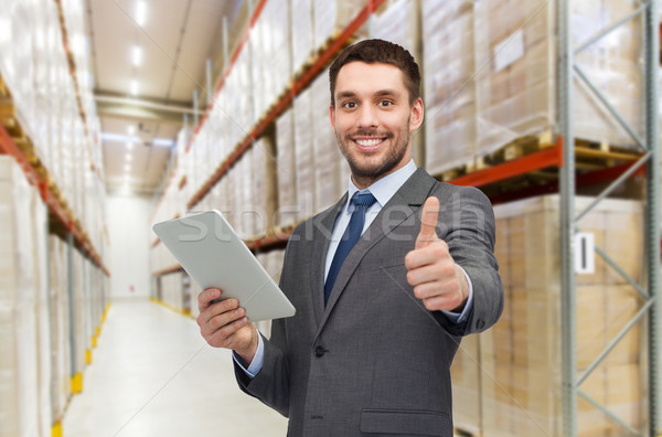 businessman with tablet pc over warehouse Stock photo © dolgachov