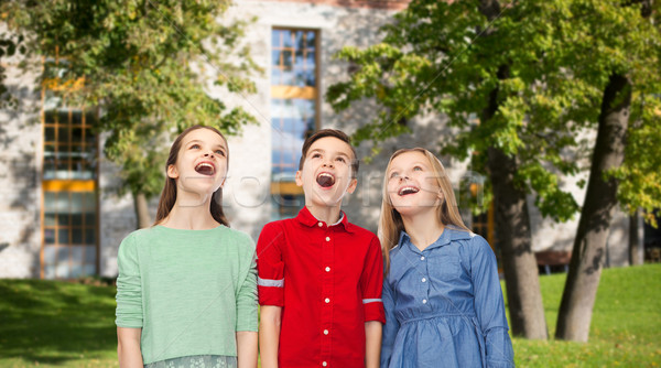amazed children looking up over summer campus Stock photo © dolgachov