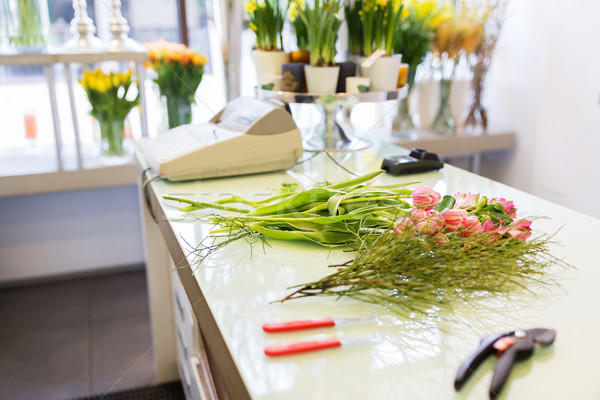 close up of floristic tools on flower shop counter Stock photo © dolgachov