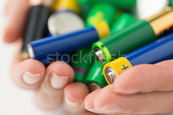 close up of hands holding alkaline batteries heap Stock photo © dolgachov