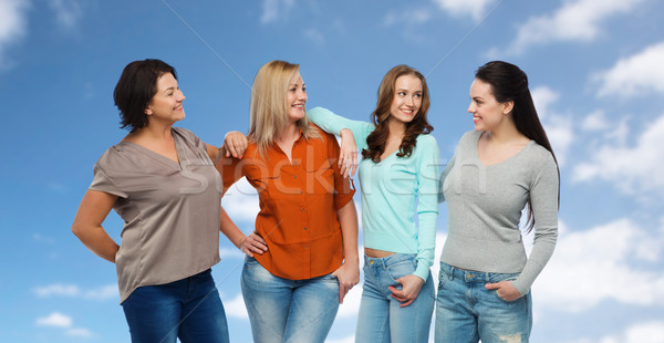 group of happy different women in casual clothes Stock photo © dolgachov