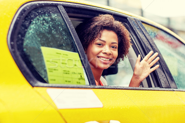 Stock photo: happy african american woman driving in taxi