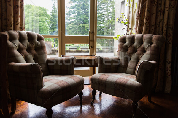 close up of vintage armchairs and table in hotel Stock photo © dolgachov