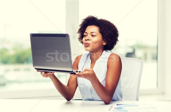Afrikai nő küldés csók laptop számítógép távoli Stock fotó © dolgachov
