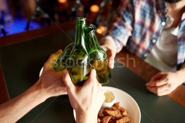 close up of friends drinking beer at bar or pub Stock photo © dolgachov