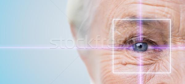 старший женщину глаза лазерного свет Сток-фото © dolgachov