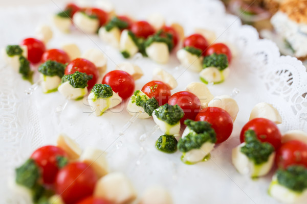 close up of mozzarella and cherry tomato canape Stock photo © dolgachov