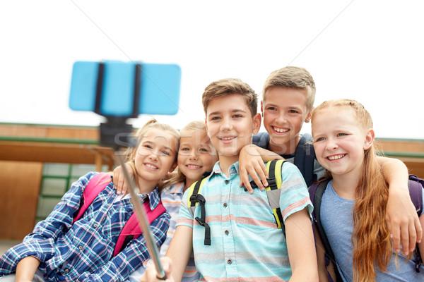 happy elementary school students taking selfie Stock photo © dolgachov