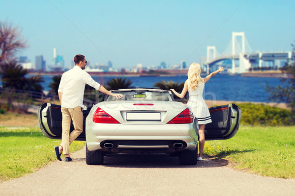 happy man and woman near cabriolet car in tokyo Stock photo © dolgachov