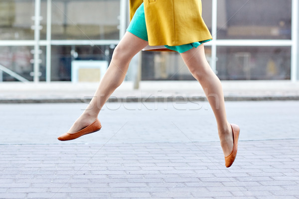 young woman or teenage girl legs on city street Stock photo © dolgachov