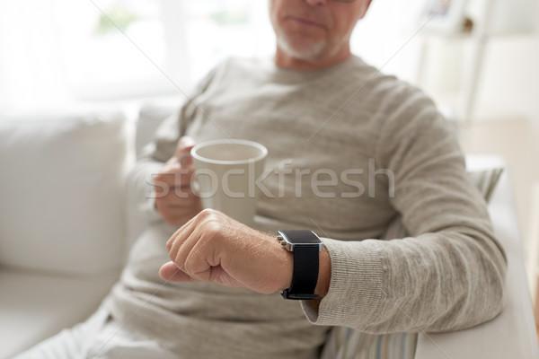 Viejo taza mirando tiempo Foto stock © dolgachov